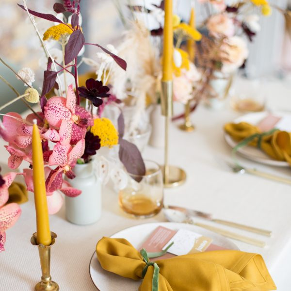 Close-up of a place setting and flowers on a wedding table