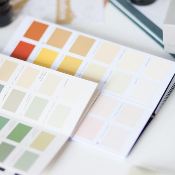Colour swatch books on a desk