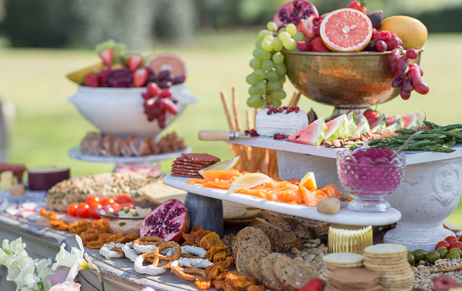 A grazing table, great for reducing wedding food waste, is laid out with colourful food