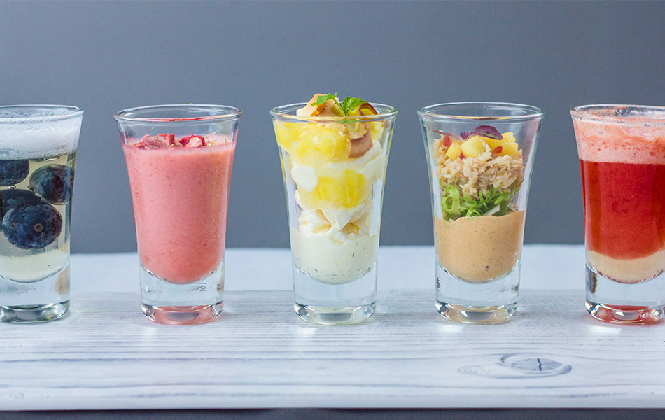 Seasonal palate cleansers presented in shotglasses and lined-up looking colourful.