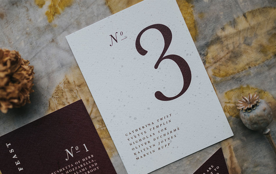 Eco-friendly stationery table number which doubles-up as a table plan with guest names listed.